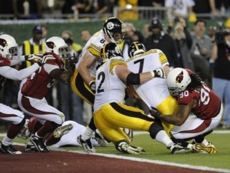 Pittsburh Steeler quarterback Ben Roethlisberger (#7) is pulled down just short of a touchdown by Darnell Dockett (#90) of the Arizona Cardinals in the first quarter of Super Bowl XLIII at Raymond James Stadium in Tampa, Florida on February 1, 2009.     A