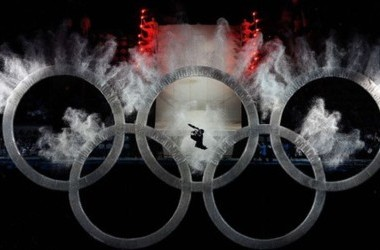 VANCOUVER, BC - FEBRUARY 12: A snowboarder flies thru the Olympic Rings during the Opening Ceremony of the 2010 Vancouver Winter Olympics at BC Place on February 12, 2010 in Vancouver, Canada.   Kevork Djansezian/Getty Images/AFP== FOR NEWSPAPERS, INTERNE