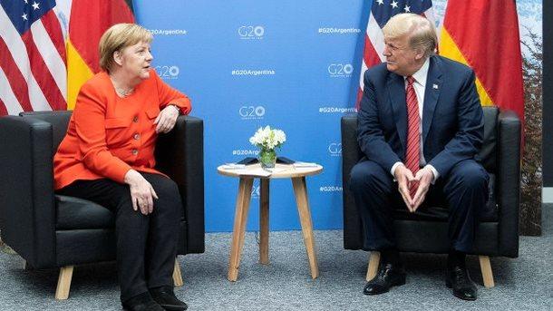 Меркель и Трамп на саммите G20. Фото: twitter.com/RegSprecher