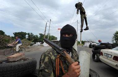 Террористы в Донбассе массово насилуют женщин. Фото: AFP