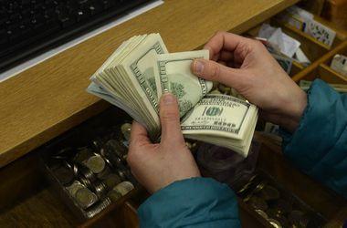Доллар в Украине будет еще расти, считают эксперты. Фото:AFP