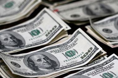Ситуация на валютном рынке пока останется нестабильной, считают аналитики. Фото: AFP