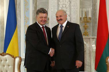 Порошенко и Лукашенко. Фото: AFP