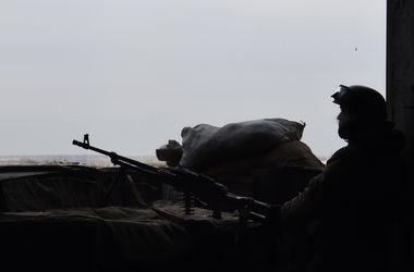 За сутки боевики убили 9 украинских военных. Фото: AFP