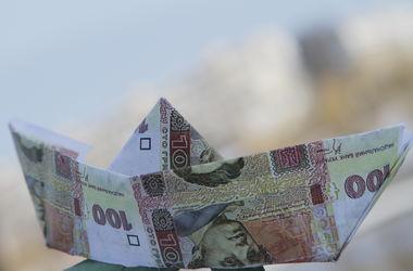 Гривня упала в ожидании транша от МВФ