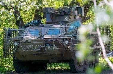 Украина готова продолжить отвод тяжелого вооружения. Фото: AFP
