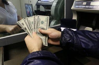 Курс доллараза последнее время серьезно вырос. Фото: ТАСС