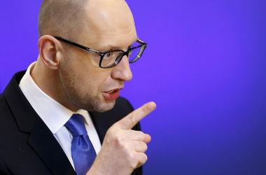 Яценюк считает, что Украина стала богаче. Фото: AFP