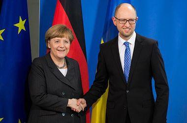 Ангела Меркель і Арсеній Яценюк. Фото: архів