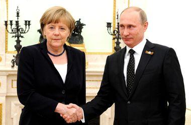 Ангела Меркель и Владимир Путин. Фото: AFP