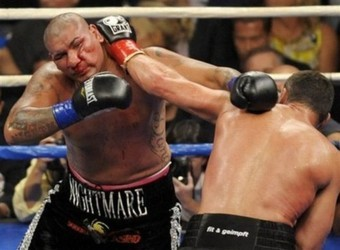 Chris Arreola, of Riverside, Calif., left, absorbs a blow from World Boxing Council heavyweight champion Vitali Klitschko in the 9th round of their WBC heavyweight title boxing match in Saturday, Sept. 26, 2009, in Los Angeles. Klitschko won by TKO at the